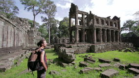 Backpacker looking preah khan temple, angkor, cambodia stock video