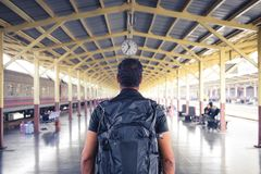 Backpacker looking time at clock in railway station . Bangkok , Thailand , Asia Royalty Free Stock Images