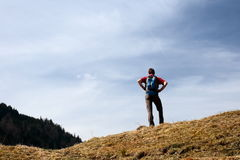 Backpacker is looking to the nature Royalty Free Stock Photo