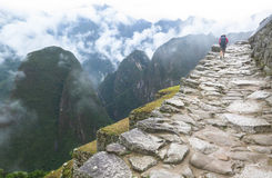 A backpacker in Machu Picchu in Peru Royalty Free Stock Photography