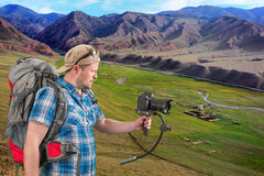Backpacker making makes shooting of scenery landscape Royalty Free Stock Photo