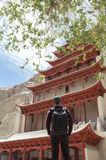 A Backpacker at Mogao Caves in Dunhuang, China Royalty Free Stock Photo