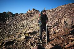 Backpacker in morning mountains Royalty Free Stock Photography