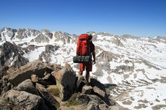 Backpacker on mountain Stock Photo