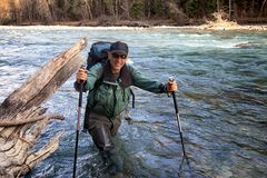 Backpacker and mountain river Stock Photography