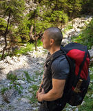 Backpacker on mountain trail Royalty Free Stock Photos