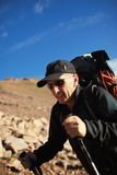 Backpacker in mountains Royalty Free Stock Photo