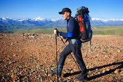Backpacker in mountains Royalty Free Stock Photography