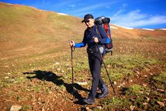Backpacker in mountains Stock Image