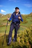 Backpacker in mountains Royalty Free Stock Images