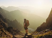 Backpacker at mountains Stock Photography