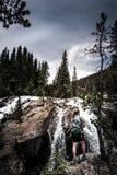 Backpacker near Jasper Creek Falls Colorado Indian Peaks Wildern. Hiker at Jasper Creek Falls near lost lake Stock Images