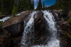 Backpacker near Jasper Creek Falls Colorado Indian Peaks Wildern. Hiker at Jasper Creek Falls near lost lake Stock Photos