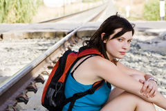 Backpacker near railway Royalty Free Stock Image