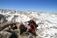 Backpacker near summit Stock Images