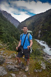 Backpacker in Nepal. Backpacker in the mountains of Everest base camp trail in Nepal Stock Photos