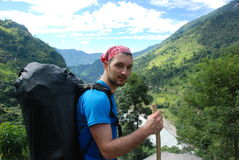 Backpacker in the outdoors. A backpacker in the mountains of Nepal Stock Image