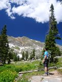 Backpacker in the outdoors. A backpacker in the mountains of Colorado Stock Image