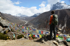 Backpacker in the outdoors. Backpacker in the mountains of Everest base camp trail in Nepal Stock Image