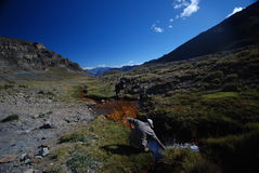 Backpacker in the outdoors filling water royalty free stock images