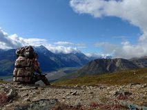 Backpacker overlooking Alaskan valley Royalty Free Stock Images