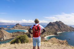 A backpacker at PADAR ISLAND, Komodo National Park, Indonesia. This photo is taken in Komodo National Park, Indonesia. Komodo, Rinca, and Padar Island are the royalty free stock photos