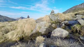Backpacker and photographer hiking in the italian Alps stock video footage