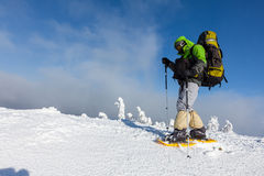 Backpacker is posing in winter mountains Stock Image