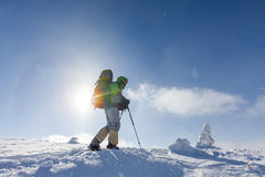 Backpacker is posing in winter mountains Royalty Free Stock Photos
