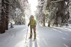 Backpacker posing in winter mountains Stock Image