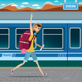 Backpacker at the railway station. European tourism concept, smiling backpacker walking at the railway station and waving Royalty Free Stock Image