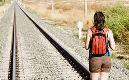 Backpacker on railway tracks Royalty Free Stock Photos