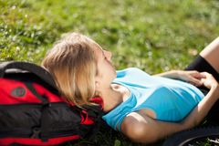 Backpacker relaxation lying in the fresh grass Stock Photos