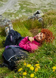 Backpacker resting on mountain trail Royalty Free Stock Photos