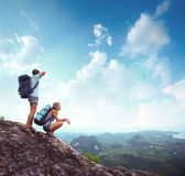 Backpacker on a rock Royalty Free Stock Photography