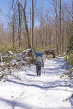 Backpacker on a Snowy Trail after a Spring Snow Royalty Free Stock Photo