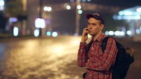 Backpacker Speaks by Phone stock footage
