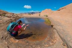 Backpacker splashing water, Stock Photos