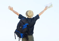 Backpacker standing with arms outstretched Stock Images