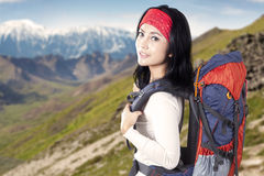 Backpacker standing on the edge of mountain Royalty Free Stock Image