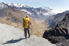 Backpacker standing hiking tourist mountain edge trail, Bolivia Royalty Free Stock Images