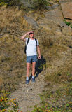 Backpacker standing on a mountain park Stock Image