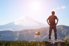 Backpacker standing on the rock Royalty Free Stock Image