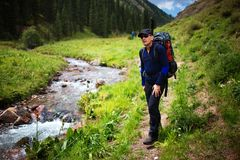 Backpacker in summer mountains Royalty Free Stock Photos
