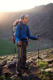 Backpacker in summer mountains Royalty Free Stock Photo