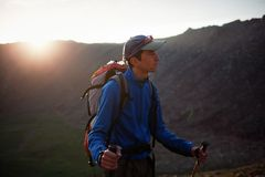 Backpacker in summer mountains Stock Image