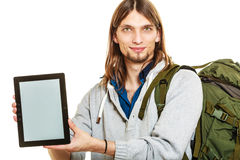 Backpacker with tablet. Blank screen copyspace. Royalty Free Stock Photography