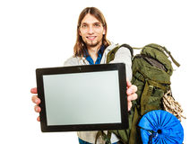 Backpacker with tablet. Blank screen copyspace. Stock Images