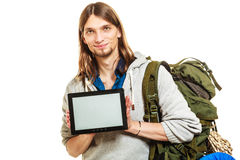 Backpacker with tablet. Blank screen copyspace. Royalty Free Stock Photo