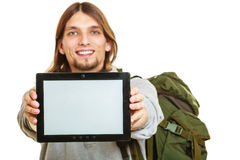 Backpacker with tablet. Blank screen copyspace. Stock Photos